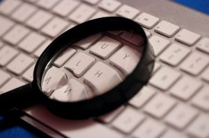 magnifying-glass-atop-computer-wireless-keyboard-725x483